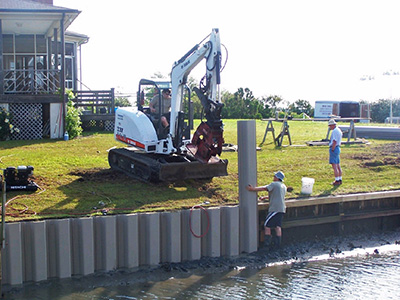 Vinyl sheet piling everlast synthetic products for Wood piling foundation cost